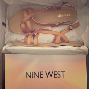 Light brown, flat, straps sandals.